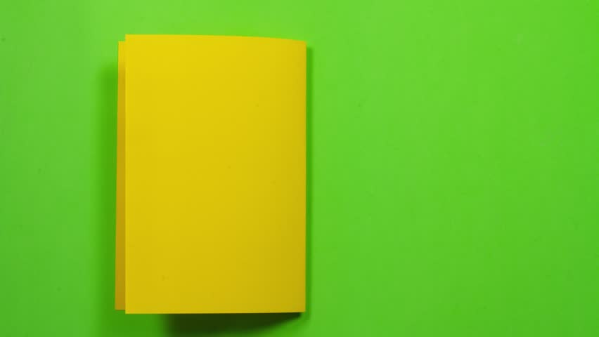 Yellow sheet of paper folds and gets into a white envelope. Then leaves screen on the right. seamless loop. With alpha channel / luma matte to add copy and remove background. | Shutterstock HD Video #1016328811