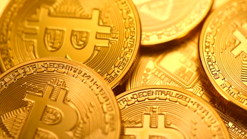 Bitcoin. Crypto currency Gold Bitcoin, BTC, Bit Coin. Macro shot of Bitcoin coins rotated background Blockchain technology, bitcoin mining concept. 4K UHD video