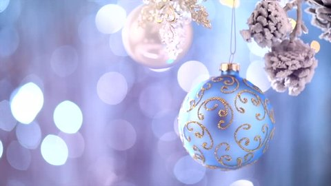 Christmas and New Year Decoration. Abstract Silver Blurred Bokeh Holiday Background. Blinking Garland. Christmas Tree decorated with baubles, Lights Twinkling. 4K UHD video