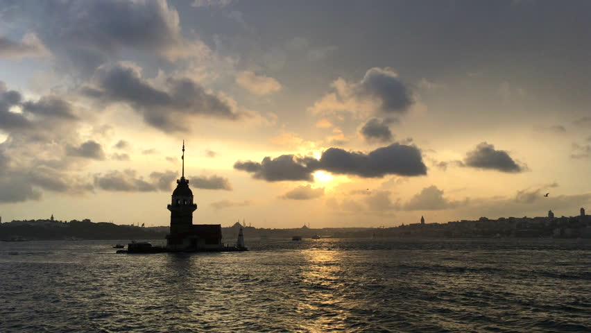 Back light evening view of the Maiden's Tower, Turkish Kiz Kulesi. It is a tower lying on a small island located at the southern entrance of the Bosphorus coast of Uskudar in Istanbul