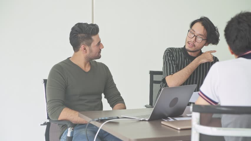 Business meeting. Small start up business meeting in room. Asian team with indian man brainstorming the next big idea. New business model start up concepts. | Shutterstock HD Video #1016396611