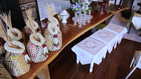 Pan left camera, gift and worship at Lanna wedding