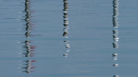 reflection of harbor mooring on water in harbor of Altnau. lake Bodensee, CH Switzerland. 13th Sept.2018