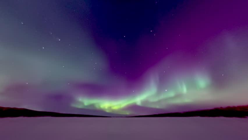 Spectacular aurora over frozen lake