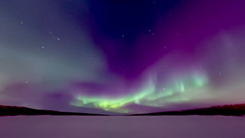 spectacular aurora over frozen lake
