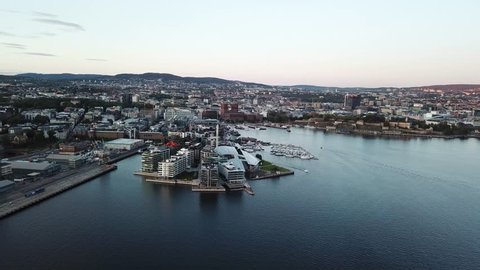 Night aerial crane footage on Aker Brygge and Filipstad urban areas in Oslo, Norway