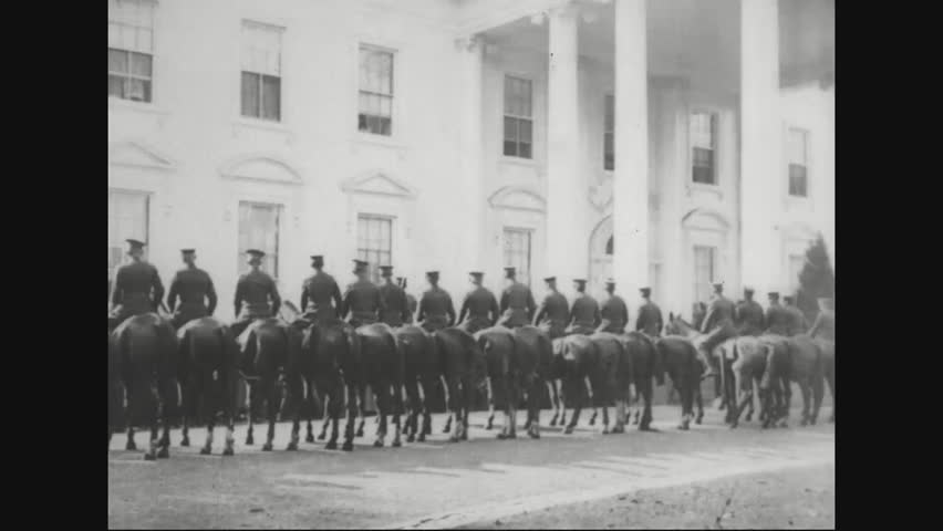 CIRCA 1920s - Marshal Ferdinand Foch steps out of a car at the White House and mounted troops are shown in Washington, D.C.