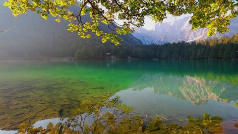 Wonderful summer view of Fusine lake. Bright morning scene of Julian Alps with Mangart peak on background, Province of Udine, Italy, Europe. Full HD video (High Definition).