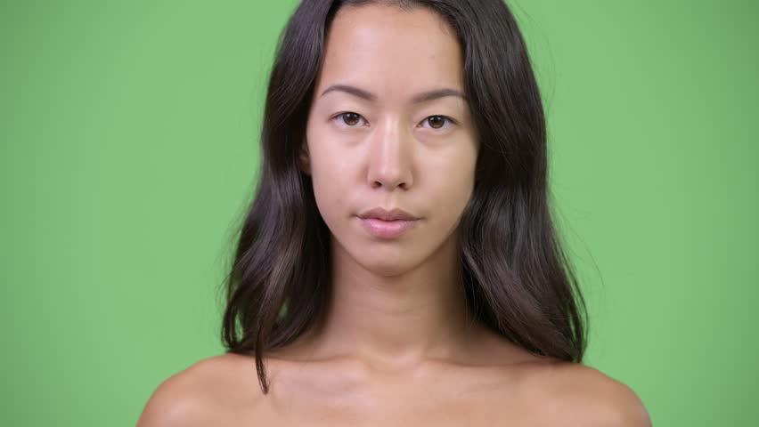 Young beautiful multi-ethnic woman shirtless | Shutterstock HD Video #1016554981