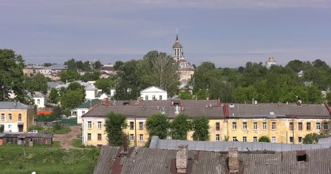 4K summer day video view of of small vintage town Torzhok center, its old vintage architecture and monuments on Tvertsa River in Tver Oblast, half way between Moscow and Saint Petersburg, in Russia