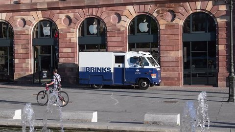 STRASBOURG, FRANCE - SEP 12, 2018: Morning street city scene with Brinks armored security truck cash transportation from Apple Store in France