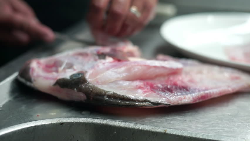 Filleting the golden fish in the restaurant