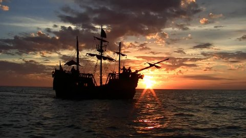 Pirate ship at sunset in the Caribbean