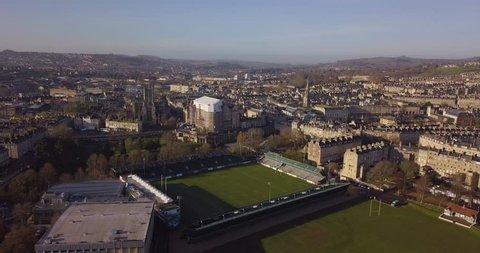Aerial footage of Bath skyline with Stadium of Bath, Bath Abbey and river Avon on a sunny day