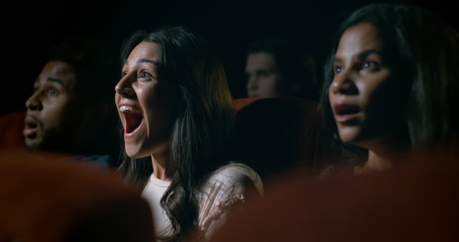 Happy and entertained movie theatre audience enjoying a great movie theatre experience. | Shutterstock HD Video #1016723821