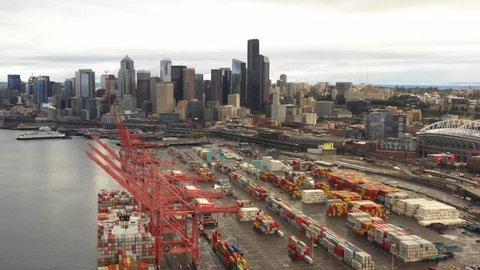 Aerial industrial port with view of Seattle Downtown 4k