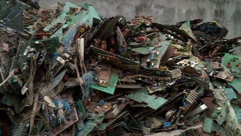 close-up on a Mountain of electronic waste in Abidjan, Africa - E-waste from Old Computers and Equipements, is a major concern to ecologists around the world.