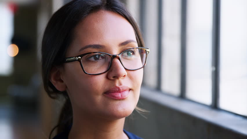 Young businesswoman wearing glasses smiling, close up | Shutterstock HD Video #1016817901