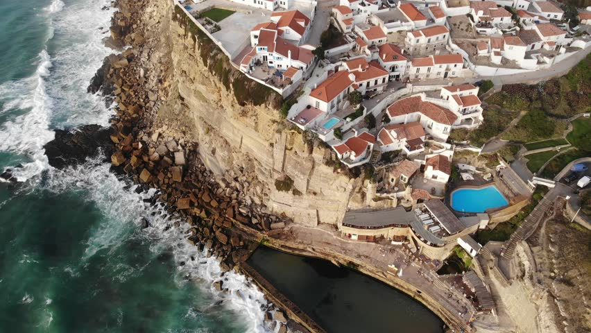 Aerial view of Azenhas Do Mar, municipality of Sintra, a seaside village on the Portuguese coast northwest of Lisbon, Portugal, shot from drone, with Atlantic Ocean view  | Shutterstock HD Video #1016892811
