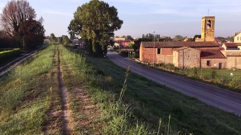 Tuscan countryside road: Ghezzano, province of Pisa, September 2018. Light traffic