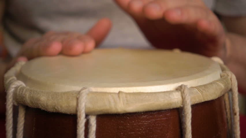 Close up of hands of a man playing a drum. Slow Motion.
