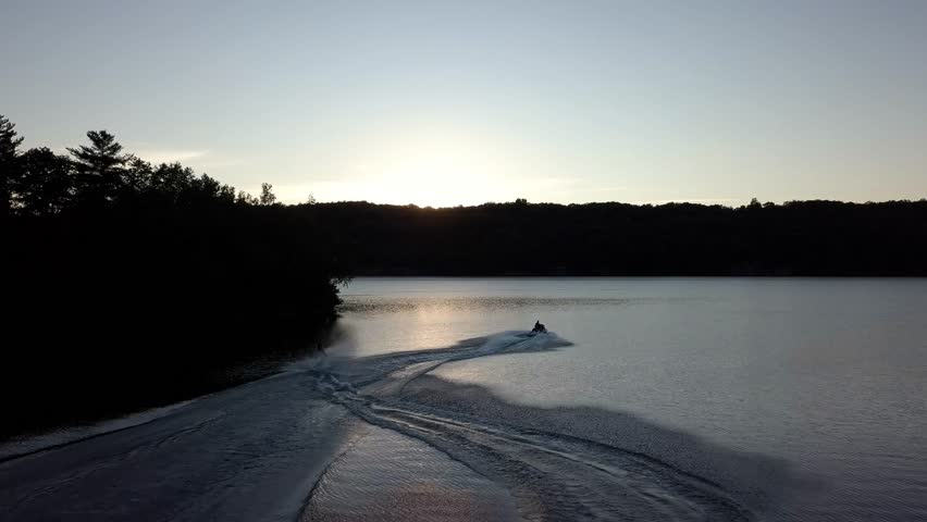 Water Skiing into Sunset | Shutterstock HD Video #1016964451
