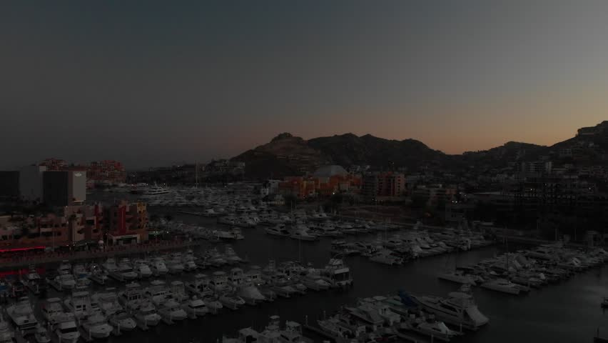 Aerial clip of the sunset while flying over La Marina of Cabo San Lucas in Baja, México.