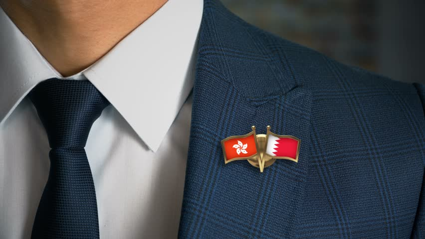 Businessman Walking Towards Camera With Friend Country Flags Pin Hong Kong - Bahrain