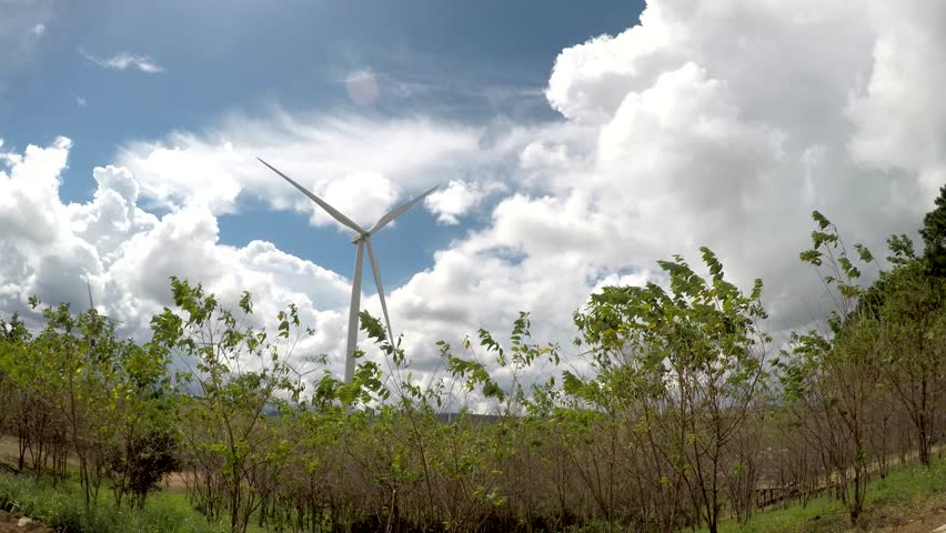 Economy and Green nature environment with clean energy. Wind farm.