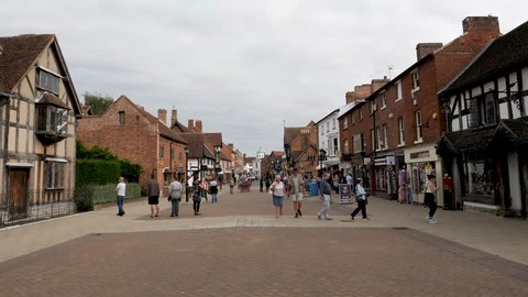 STRATFORD-UPON-AVON,ENGLAND-SSEPT. 2, 2018: People walking along Henley Street past William Shakespeare's birth place in Stratford-upon-Avon a medieval marketing town in England's west midlands