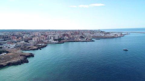 Aerial video. Old Town of Monopoli - city on Adriatic Sea. Province of Bari, region of Apulia. Italy. 4K