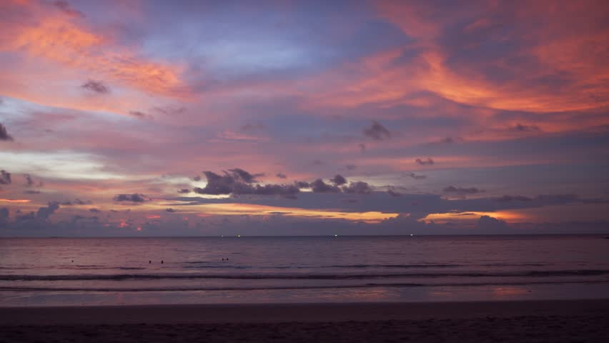 Thailand Phuket Sunset. Sun setting over the horizon of an exotic tropical sea. in brilliant. dramatic colors of orange. blue and purple. 4k video #1017152521