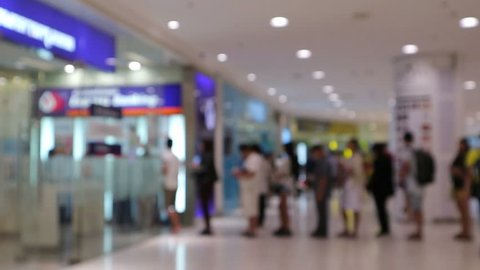 Blur or Defocus Background of People line up to use Banking Machine or ATM(Automatic Teller Machine) to Deposit, Withdraw and Transfer Money, Bangkok Thailand