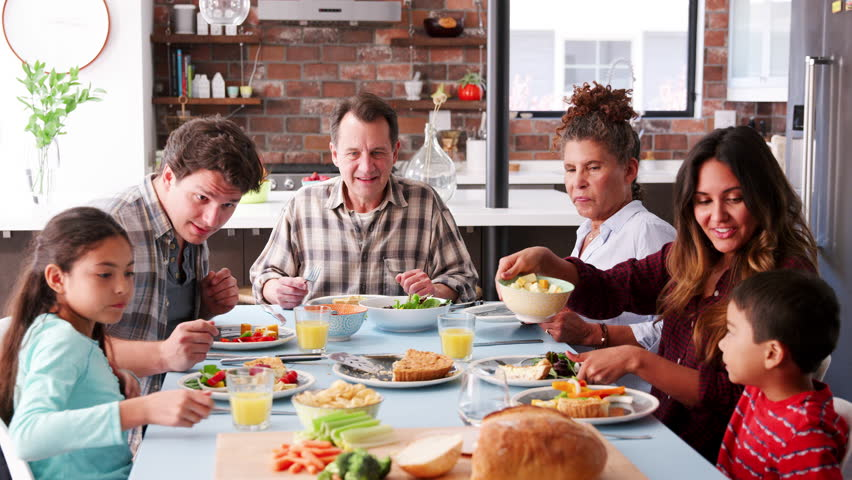 Multi Generation Family Enjoying Meal Around Table At Home | Shutterstock HD Video #1017166951