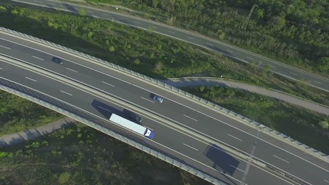 AERIAL: Freight truck driving over the viaduct highway