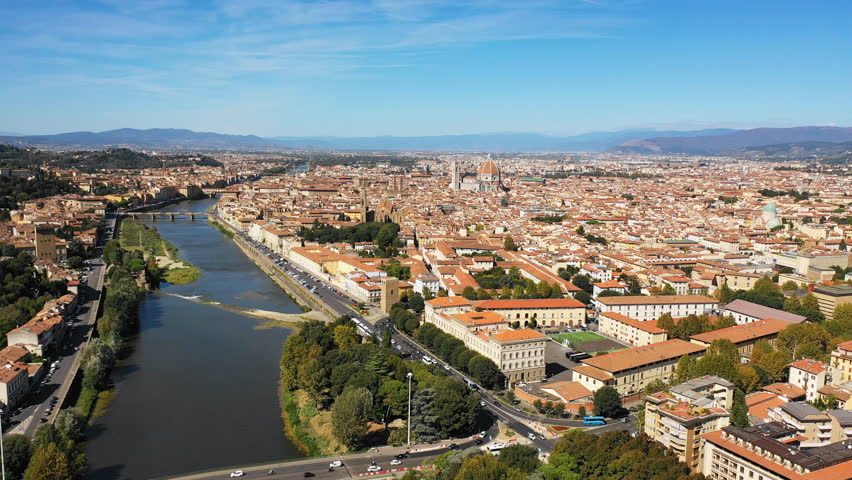 Aerial panoramic view of cityscape of Florence, famous historical city, domed cathedral Santa Maria del Fiore (The Duomo), landscape panorama of Italy from above, Europe | Shutterstock HD Video #1017185551