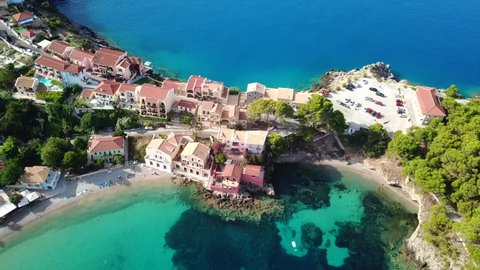 Aerial drone bird's eye view video of beautiful and picturesque colourful traditional fishing village of Assos in island of Cefalonia, Ionian, Greece