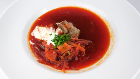 Borscht, a sour soup in Eastern Europe, with meat and sour cream, served in Restaurant