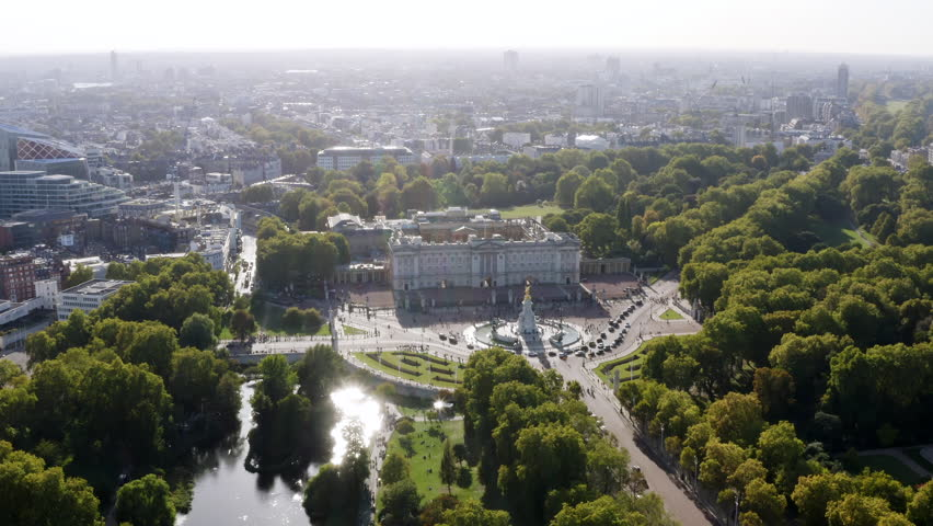 Aerial View of Buckingham Palace The Queen's official London residence home and a working royal palace feat. Bird's Eye View Victoria Memorial and St James's Park in London, United Kingdom 4K - HD | Shutterstock HD Video #1017248791