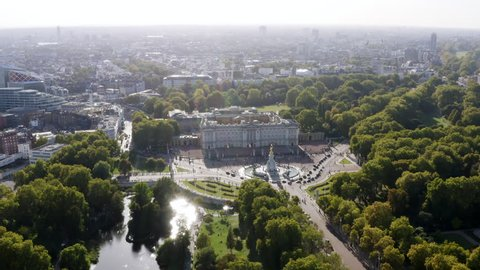 Aerial View of Buckingham Palace The Queen's official London residence home and a working royal palace feat. Bird's Eye View Victoria Memorial and St James's Park in London, United Kingdom 4K - HD