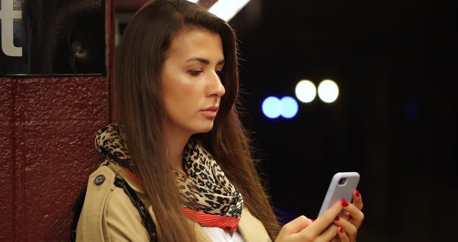 Young woman in city using cell phone at subway platform | Shutterstock HD Video #1017273091