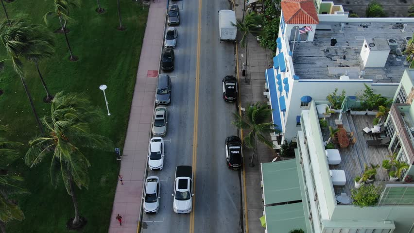 Drone Flying South To North Over City Streets Of Miami Beach, Florida, Cars Driving Through Busy City | Shutterstock HD Video #1017376201