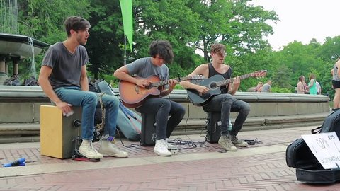 New York, United States - jun 22, 2016: Street musicians play well-known music in Central Park, New York. Well-known group performs on the street of New York, United States. Video with ambient sound.
