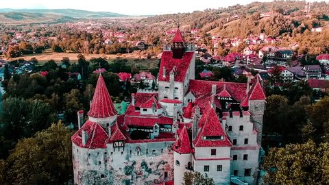 Aerial drone view getting closer Bran Dracula Castle Transylvania sunset dusk