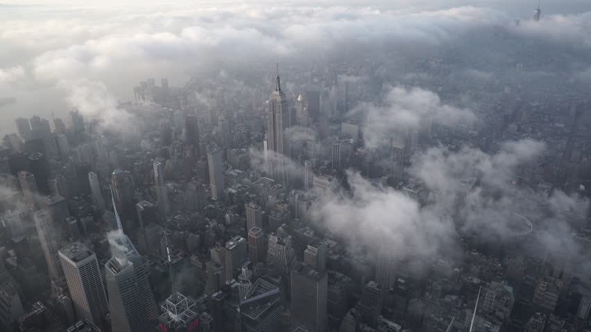 New York City Circa-2015, aerial view of from Midtown Manhattan looking south onto the Empire Building, with low level clouds at sunrise | Shutterstock HD Video #1017525091