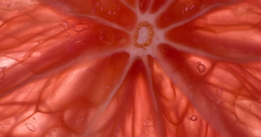 Pulp Grapefruit gives Juice. Slices and pieces of Grapefruit are compressed and crushed close-up on a bright white background, creating a juicy burst of pulp and shell. Shooting at 120fps   Shutterstock HD Video #1017546301