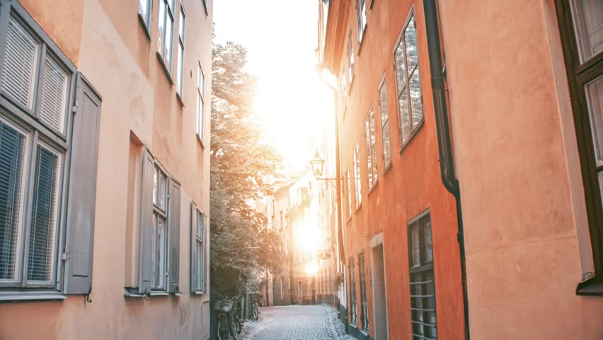 Stockholm's famous place Gamla Stan's empty street in sunny day. Old, historic, traditional Scandinavian houses. | Shutterstock HD Video #1017625741
