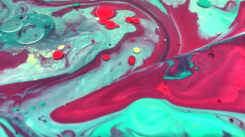 Abstract colorful bubbles marble background with milk oil and soap. Colored inks react to a drop of liquid soap in the oil.