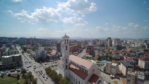 Aerial view of Pristina University Campus, in Kosovo, over the National Library, the Orthodox Church of Christ the Saviour, and the Catholic Cathedral of Mother Teresa.