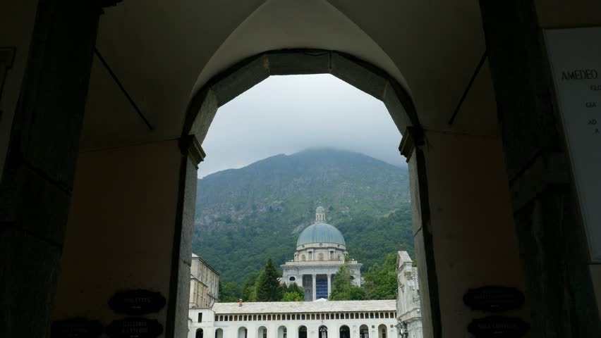 OROPA, BIELLA, ITALY - JULY 7, 2018: View of beautiful Shrine of Oropa, Facade with dome of the Oropa sanctuary located in the mountains near the city of Biella, Piedmont, Italy. | Shutterstock HD Video #1017669601